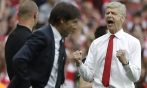 Arsenal team manager Arsene Wenger, right, celebrates his team's victory next to Chelsea team manager Antonio Conte.
