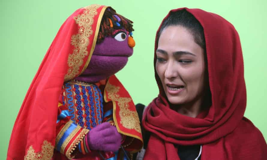 Puppeteer Mansoora Shirzad records a segment with Zari, for the puppet's first appearance on Baghch-e-Simsim.
