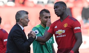 Ole Gunnar Solskjær shakes hands with Paul Pogba