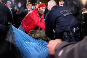 Officers were filmed pulling up tents and leaving migrants thrown to the ground.
