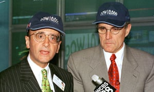 "New York Stock Exchange chairman Richard Grasso and New York City mayor Rudy Giuliani (R) wear ""Dow 10,000"" hats as the Dow Jones Industrial Average closes above 10,000 for the first time, 29 March, 1999."