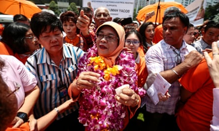 Halimah Yacob became Singapore's first female president after her two rivals failed to qualify.