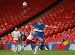 Harry Kane of England is foulded by Denmark's Andreas Christensen, who goes into the book.