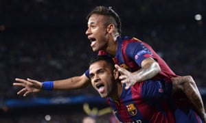 Dani Alves celebrating with his team-mate Neymar after yet another Barcelona goal, this time in the Champions League against Paris St-Germain.