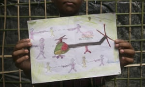 Manzur Ali,an 11-year-old Rohingya refugee who fled to Bangladesh, shows a drawing