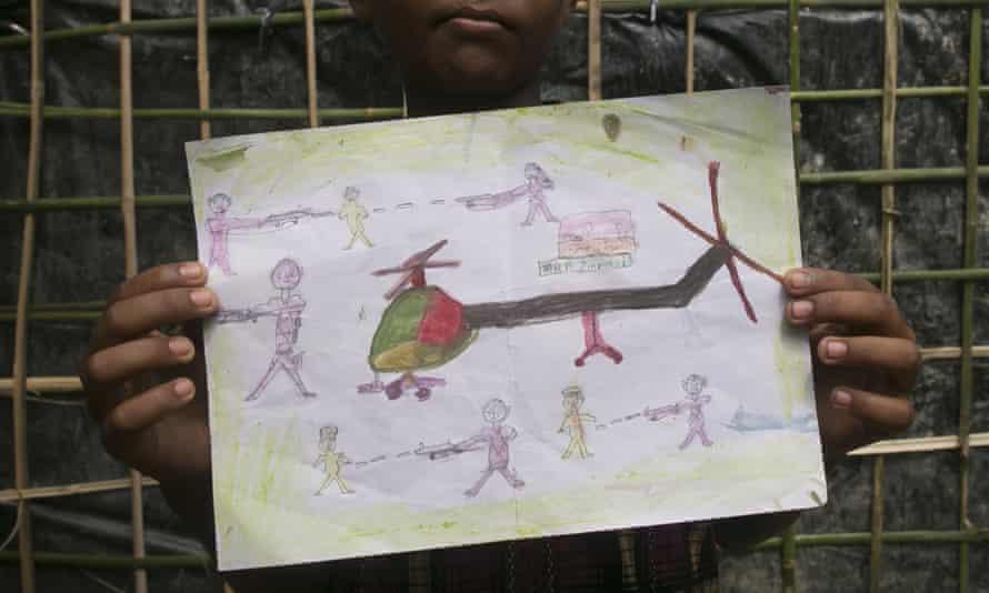 Manzur Ali,an 11-year-old Rohingya refugee who fled to Bangladesh, shows a drawing