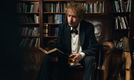 Bob Dylan, Nobel laureate, enjoys some literature and a glass of his own whiskey.