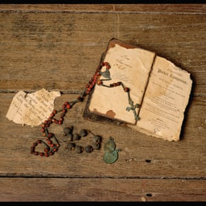Rosary beads, bible and other objects, Hyde Park Barracks circa 1980. Rosary beads (UF62), bible and other objects from the archaeology collection, Hyde Park Barracks.