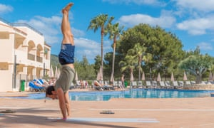 handstand by the pool
