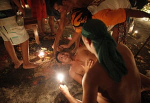 A man with chewing tobacco dripping from his mouth goes into a trance as a grandfather spirit known as a Chamarrero is believed to enter his body. Those immersed in the old tradition say it puts them in a trance that allows them to channel spirits and escape injury from otherwise dangerous feats