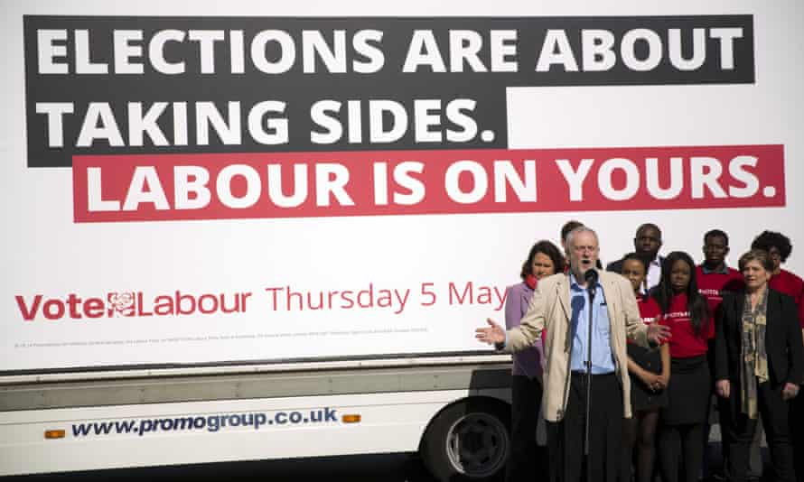 Jeremy Corbyn stands in front of a Labour campaign poster before the local elections last Thursday.