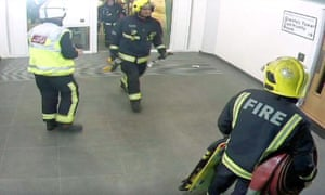 A CCTV still shows the first firefighters entering Grenfell Tower