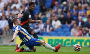 Everton's Demarai Gray shoots past Brighton and Hove Albion's Adam Webster to open the scoring.
