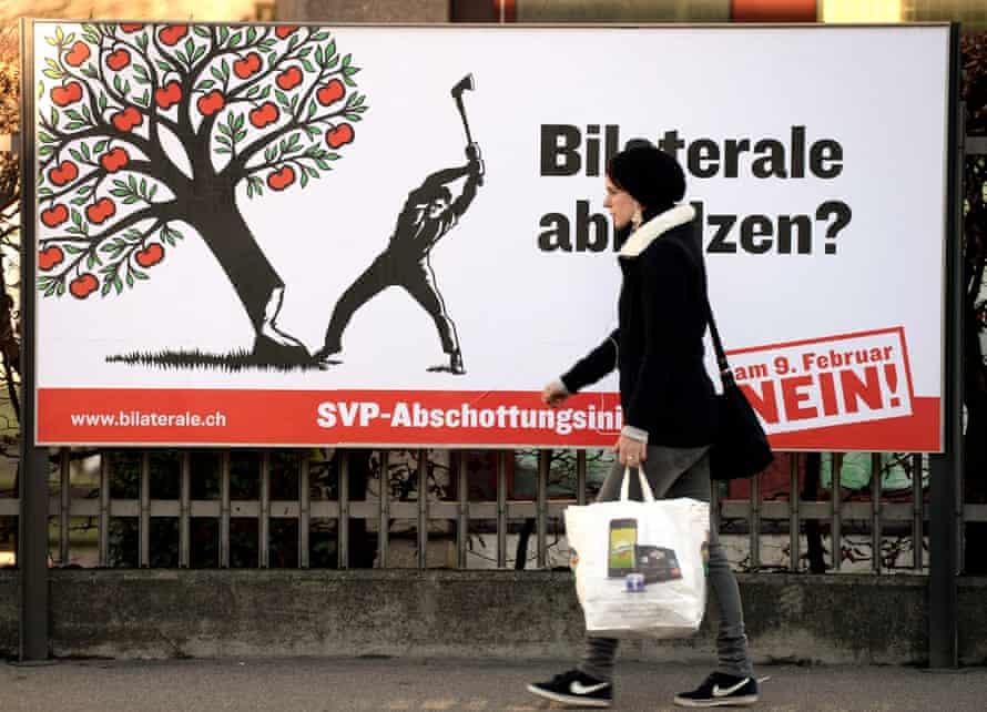 A pedestrian passes an election poster