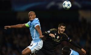 Vincent Kompany rises above Alvaro Morata.