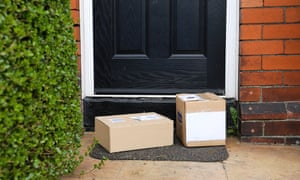 Selection of parcels in cardboard boxes outside front door