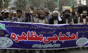 Pakistani supporters of Mumtaz Qadri at a rally in Lahore