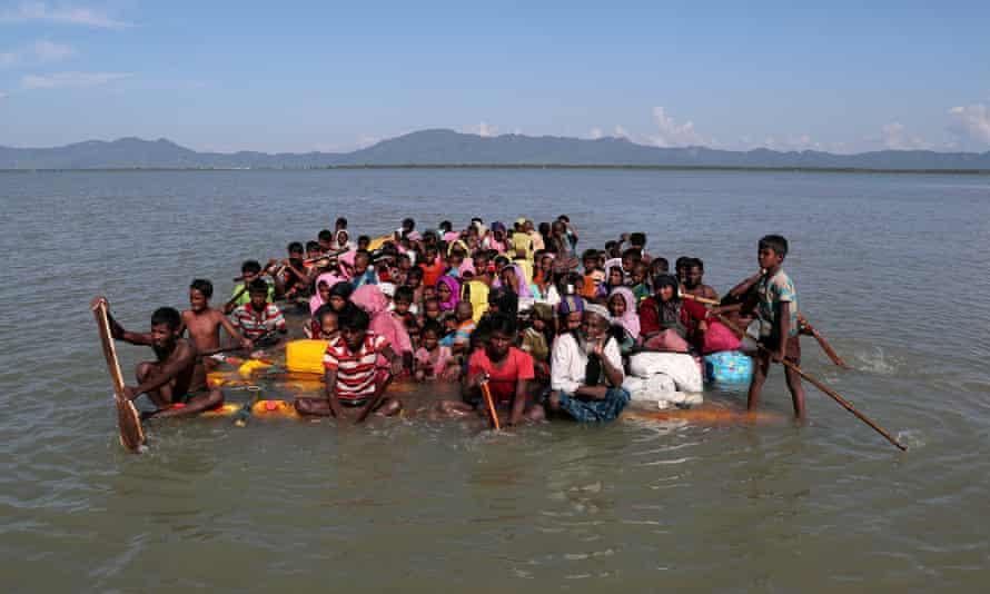 Rohingya refugees cross the Naf river to Bangladesh last year.
