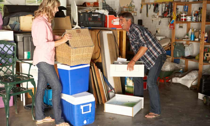 Couple stacking boxes in garage