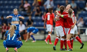 Switzerland's players, including captain Lara Dickenmann, celebrate at the final whistle.