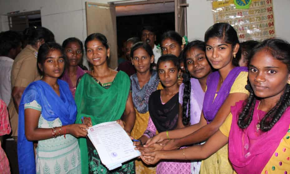 The 'young girls club' meet for their Thursday debate on ways to improve life in their village.