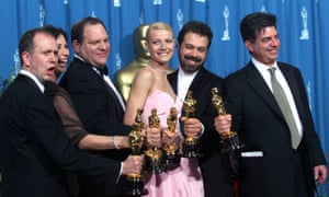 'Shakespeare in Love' Best Actress winner Gwyneth Paltrow (center) is joined by Harvey Weinstein (center left) backstage as they celebrated their win of Best Picture at the 1999 Academy Awards.