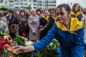 A girl lays flowers during a commemoration ceremony marking the 30th anniversary of the Chernobyl nuclear accident in Kiev