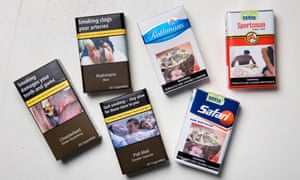 British packets of cigarettes, with stark warnings, beside packs from Africa.