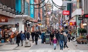 People stroll along the Drottninggatan shopping street in central Stockholm.