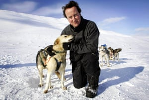 David Cameron pauses for a photo op with a team of huskies during a visit to the Scott-Turner glacier in Svalbard, Norway, 2006