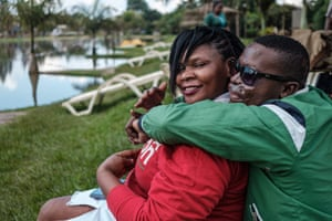 Reenah Ntoreinwe and Daniel Kasolo hug after not having seen each other in a long time in Kampala.