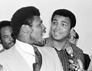 Muhammad Ali listens as Spinks has the floor for a word during their contract signing in New Orleans on 11 April 1978.