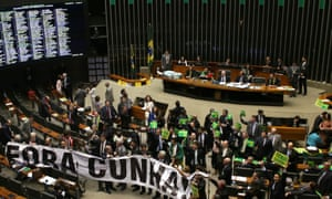 Pro-Rousseff lawmakers hold up a banner against Eduardo Cunha that reads 'Get out Cunha'.