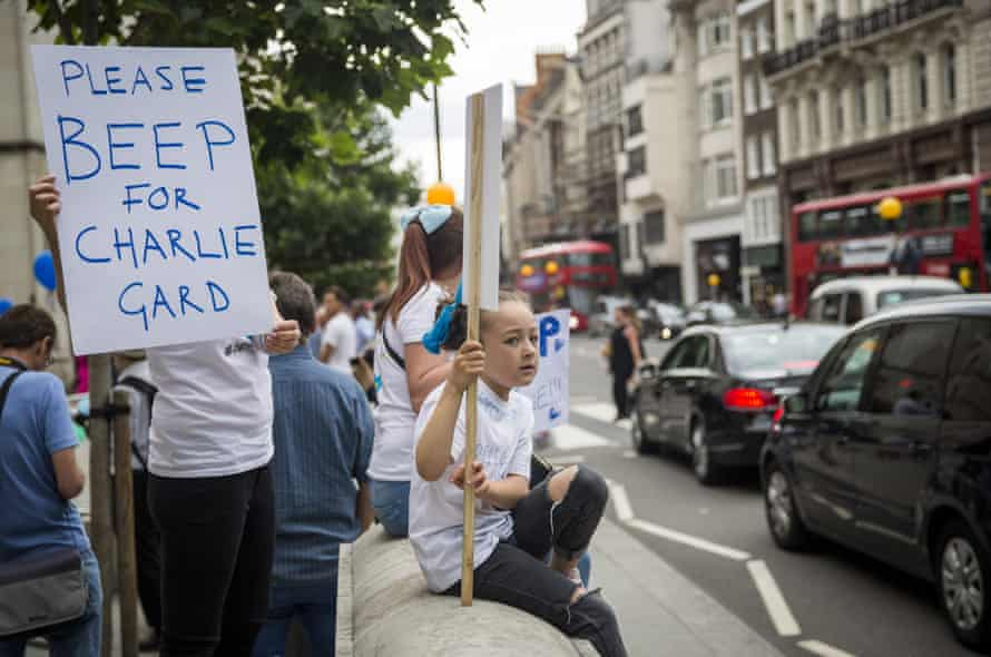 Supporters of the Charlie Gard family gather outside the Royal Courts of Justice on Thursday.