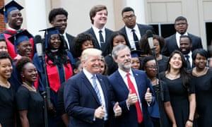 Donald Trump poses with Liberty University president Jerry Falwell Jr t the school in Lynchburg, Virginia.
