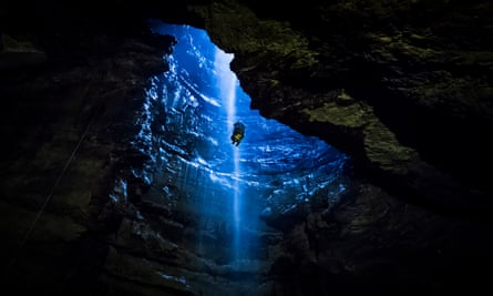 A member of the public is winched into Gaping Gill, the largest cavern in Britain