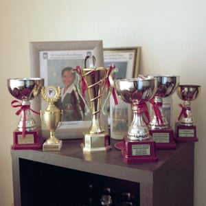 Trophies displayed in Kaylin Kleinhans' home, from various national competitions she and her older sister (who is also a drum majorette) have been involved in. Their mother is highly supportive of the girls' participation in the team; in every room there is an element of the girls' achievements on display.