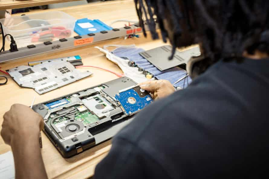 A worker repairs a device at Free Geek, which refurbishes old technology for community members in need.