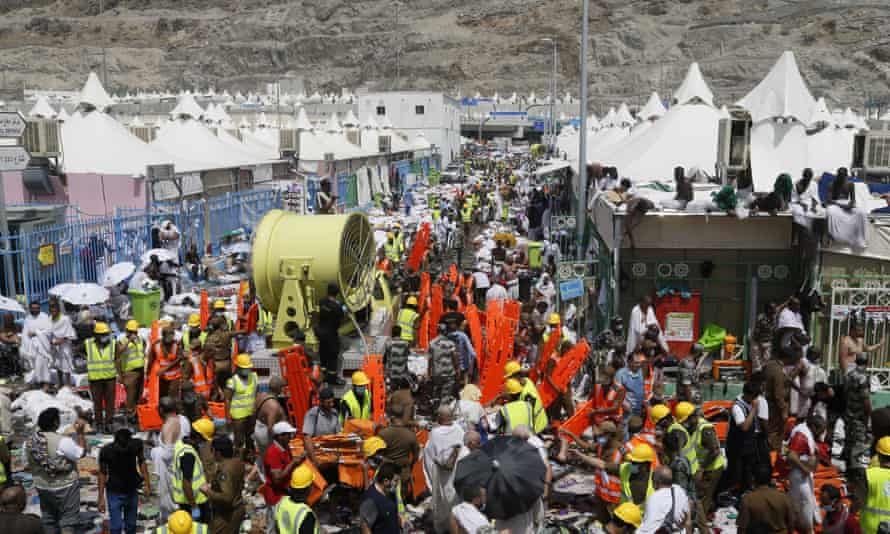 Muslim pilgrims and rescuers gather around people who died in Mina.