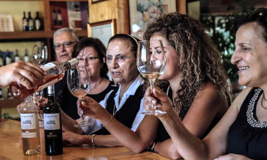 Taste of the past: tourists and visitors taste wine in the Western Beqaa District of Lebanon.