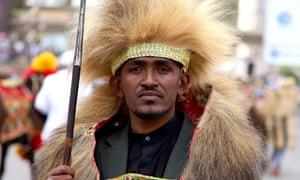 Ethiopian musician Haacaaluu Hundeessaa, in traditional costume, 2019