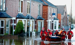 Rescue workers in Carlisle after heavy rain from Storm Desmond tore through Britain in December 2015.