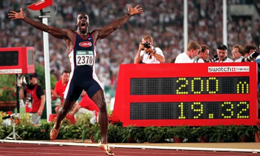 Johnson celebrates winning 200m Olympic gold in 1996 in a world record time in Atlanta.