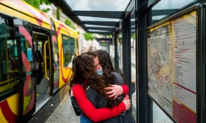 Two friends hug each other as they reunite after the lockdown in Mulhouse, eastern France, on 11 May 2020, on the first day of France's easing of lockdown measures.