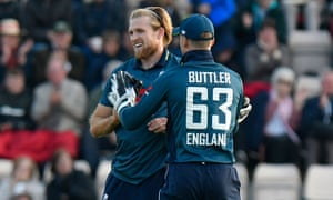 David Willey of England celebrates taking the wicket of Asif Ali of Pakistan.