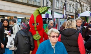 Stalker: a woman is pursued by a giant stick of rhubarb at the Wakefield Rhubarb Festival, 2015.