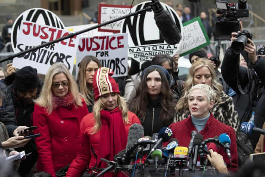 Rose McGowan, right, speaks as Rosanna Arquette, center left, listens outside a courthouse after the arrival of Harvey Weinstein in New York, New York, on 6 January.