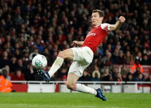 Arsenal's Stephan Lichtsteiner scores their first goal.