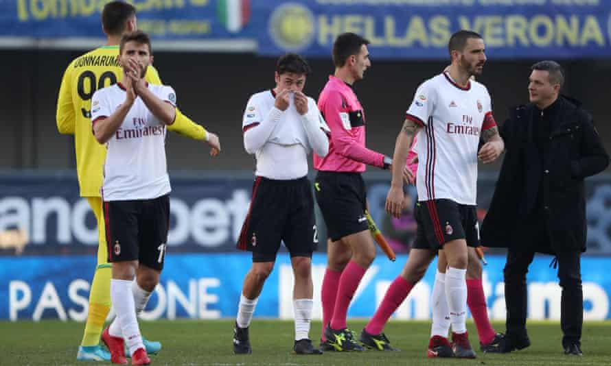 Milan's players leave the pitch after their defeat at Verona.