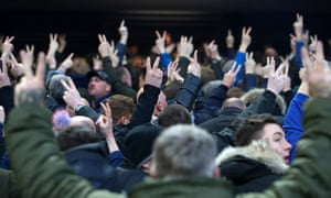 Everton fans turn their backs as Liverpool fans sing You'll Never Walk Alone at Anfield before their FA Cup match earlier this year.